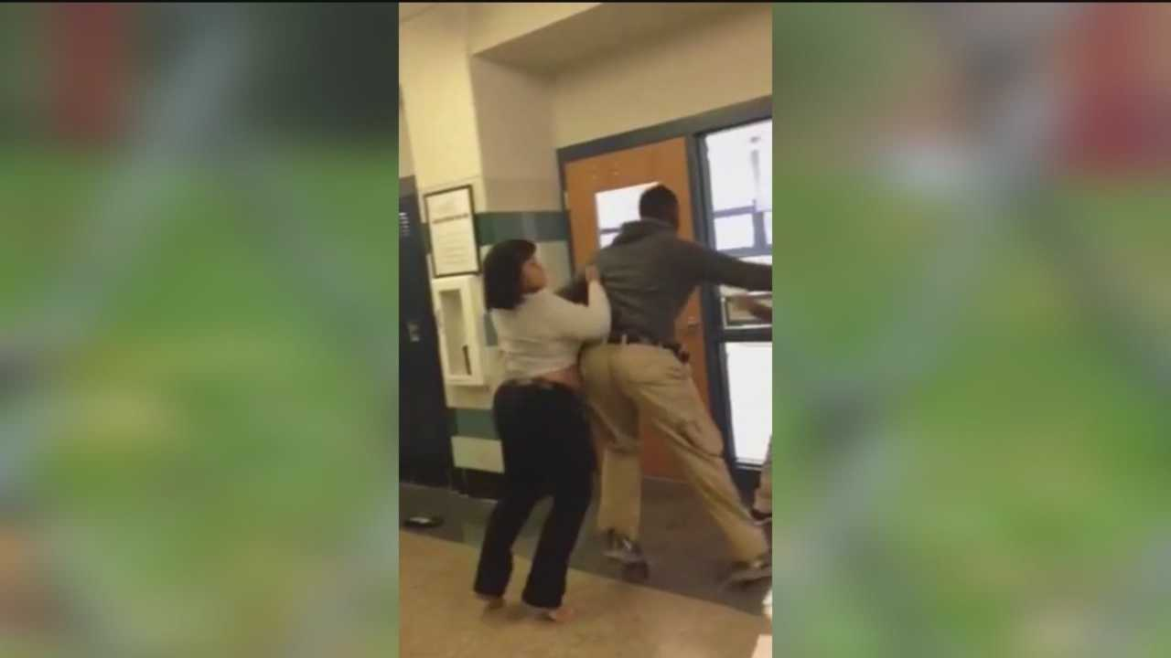 A Baltimore teacher is on administrative leave and a student is facing charges after a fight inside a school is caught on camera.