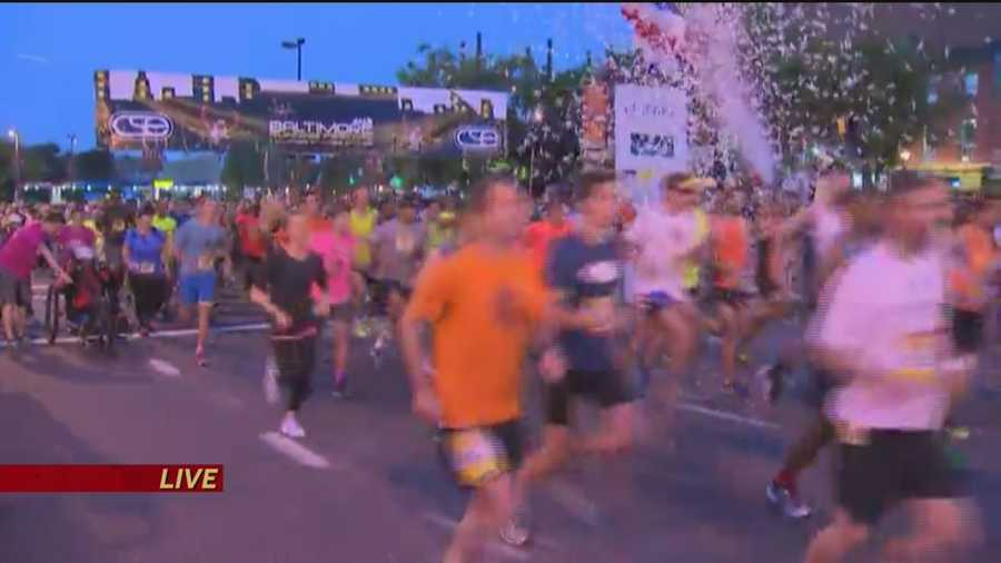 And they're off! The 2014 Baltimore Marathon officially gets started at dawn, an hour earlier than usual.