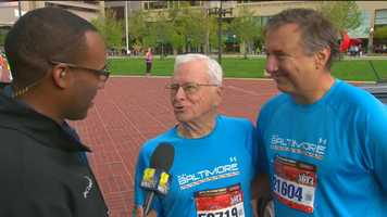 Jason Newton talks with Bob Gralley, 88, and his son, 59-year-old Craig, at the Half Marathon start about their many years of running together.