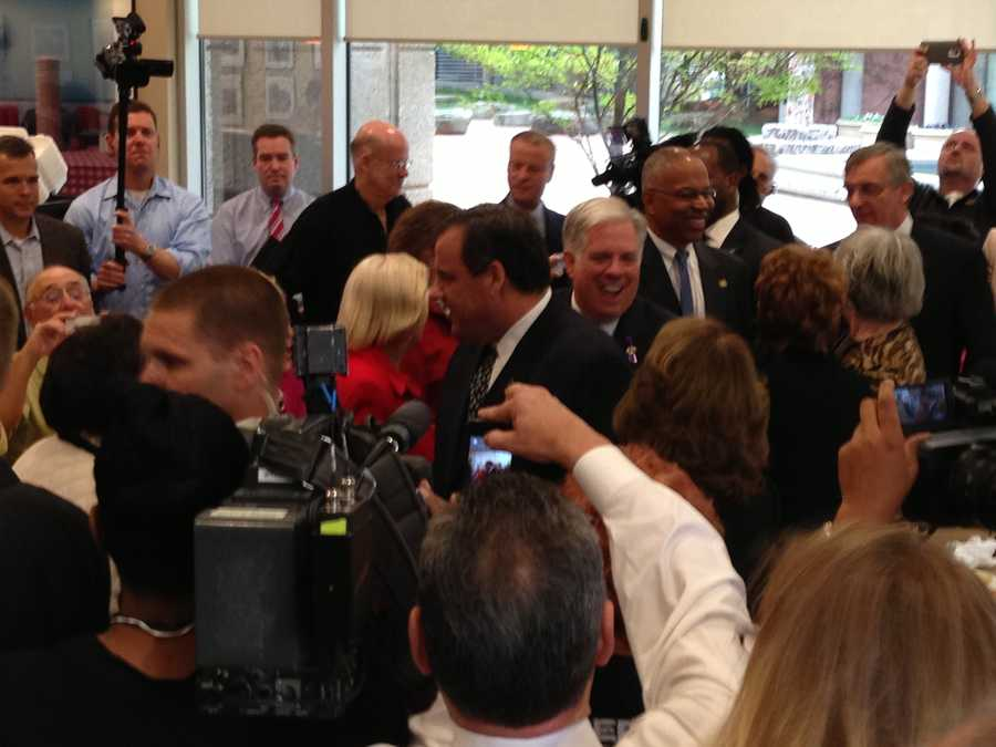 New Jersey Gov. Chris Christie, Maryland Republican gubernatorial candidate Larry Hogan and his running mate, Boyd Rutherford, wade through the crowd.
