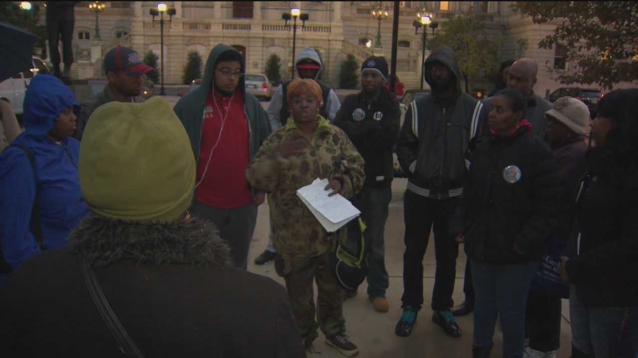 More than a dozen people gathered in front of City Hall on Wednesday night to protest incidents of alleged police brutality and demand change within the Baltimore Police Department.