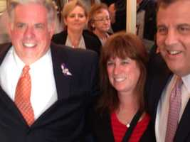 Larry Hogan and Christie get a photo with a constituent at the Honey Bee Diner in Glen Burnie.
