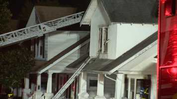 City firefighters said a woman who had to be pulled from a house fire in northeast Baltimore early Tuesday morning died.