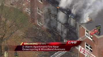 Baltimore City firefighters work to put out a big fire at an apartment complex in the northern part of the city.