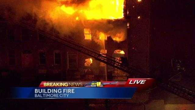 A fire consumes a home on East Lanvale Street in northeast Baltimore at 6 a.m. Monday.
