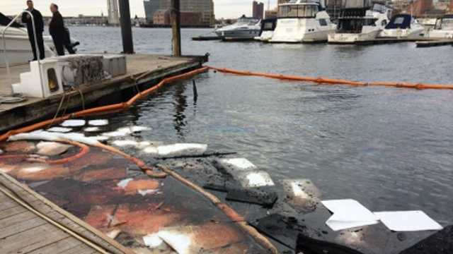 Debris and oil can be seen in the water where one of the boats sank.