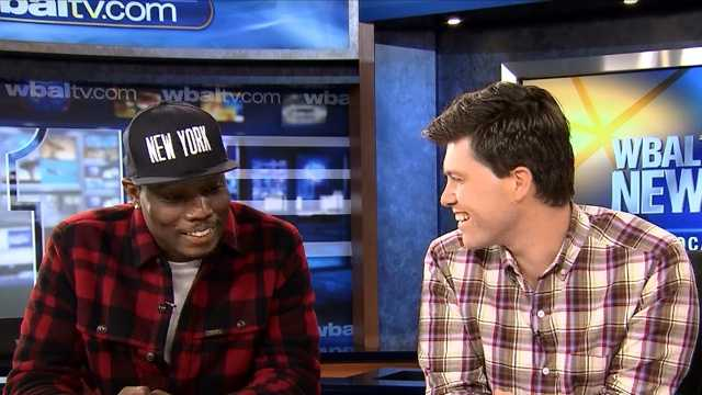 "Michael Che and Colin Jost joke around as they talk about their roles on Saturday Night Live's ""Weekend Update"" while on the WBAL-TV 11 News set."