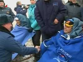 The crew of Expedition 41 said their final goodbyes to space and successfully undocked from the International Space Station around 7:30 p.m. Sunday. Here, mission Commander Max Suraev shakes hands with a Kazakhstan crew member.