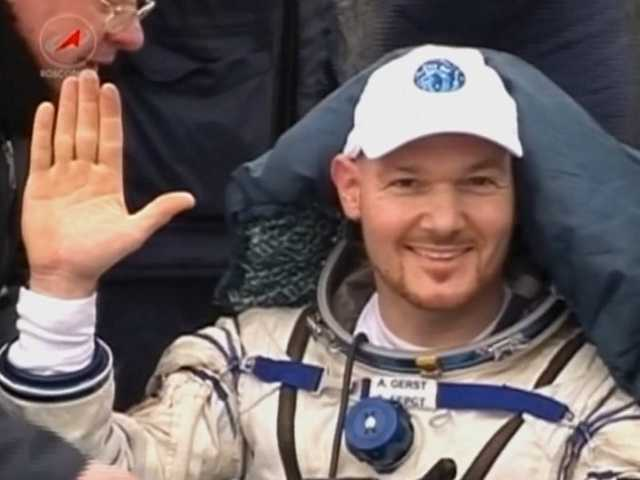 German astronaut Alexander Gerst waves to cameras upon his return.