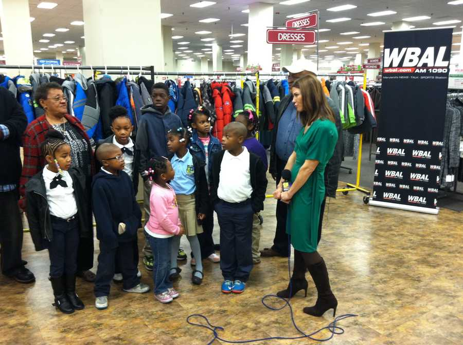 11 News reporter Megan Pringle interviews some of the children who will be getting the coats.