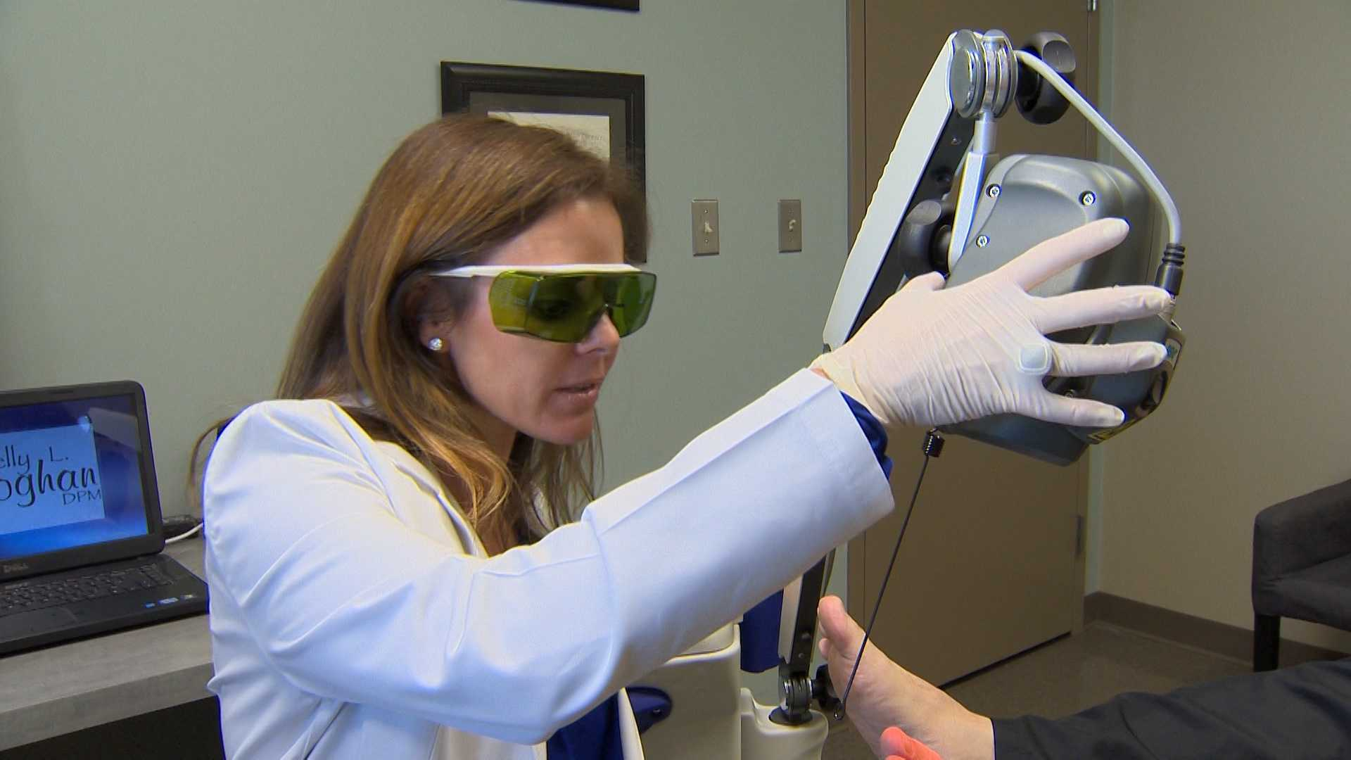 Dr. Kelly Geoghan works to relieve pain with the MLS laser.