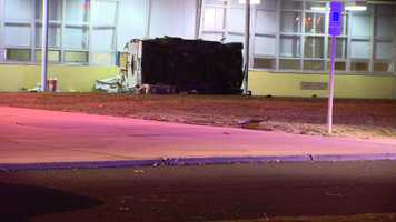 The car can still be seen on its side outside of Sparrows Point High School after it crashed into the school's cafeteria Tuesday night.