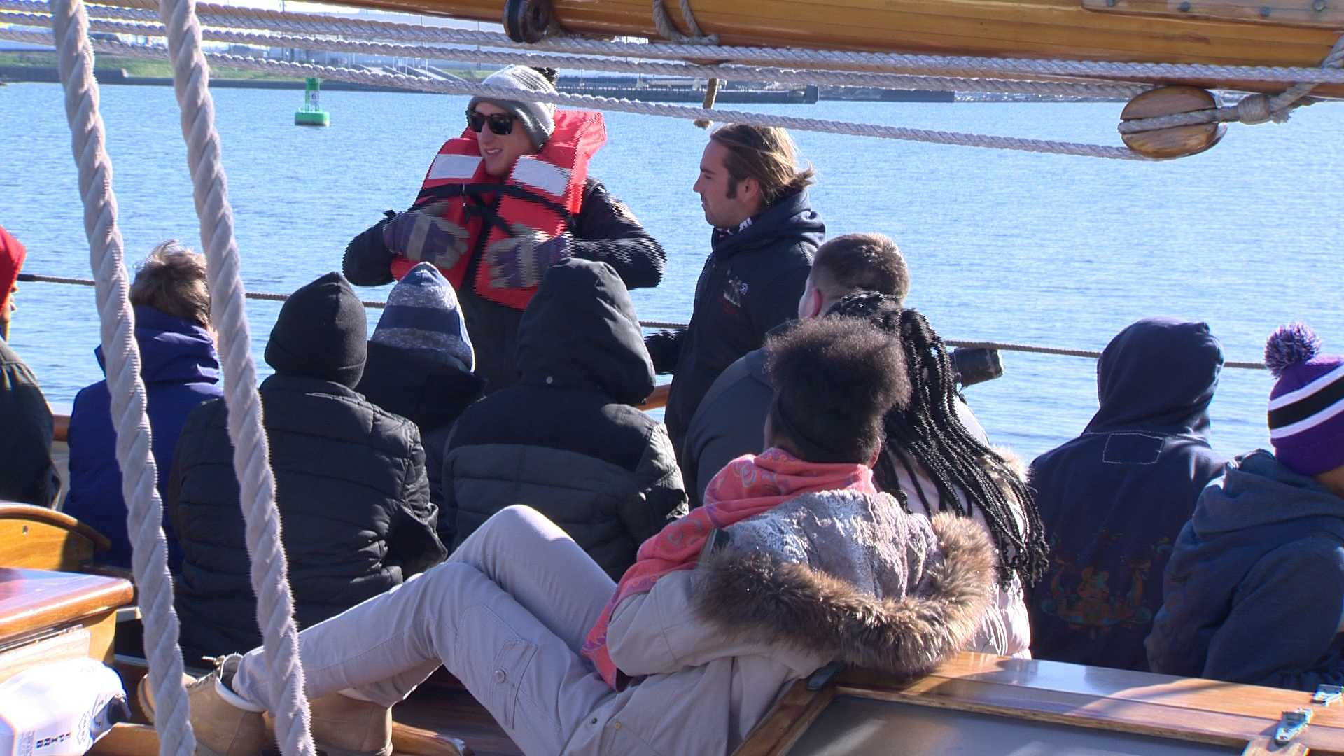 Students listen to their instructor while on the Pride of Baltimore II.