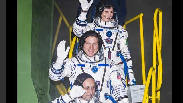 Maryland's Air Force Col. Terry Virts (center) boards a spacecraft with two other astronauts to be sent to the International Space Station.