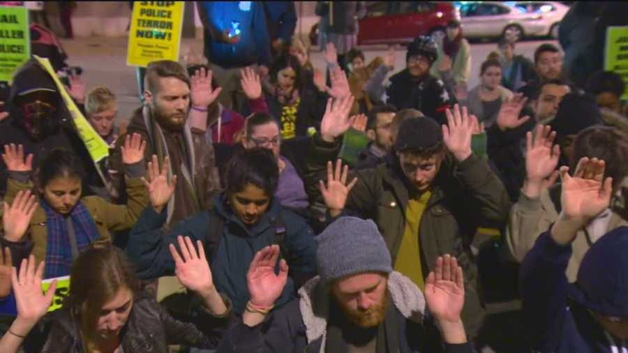 Some demonstrators got down on their knees, put their hands up and prayed.