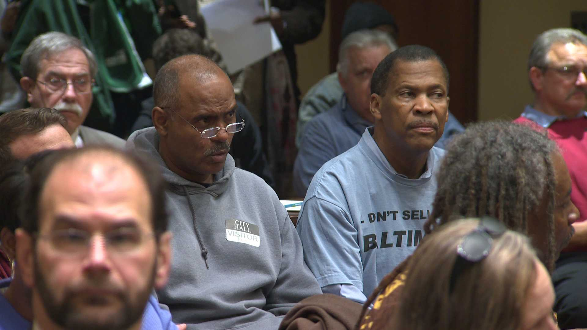 One Baltimore coalition members listen in during the council meeting.