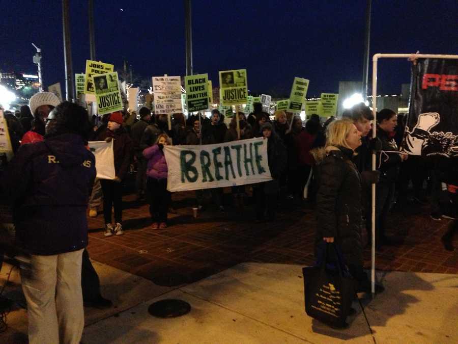 Protesters gather in McKeldin Square in downtown Baltimore