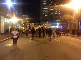 Protesters leave McKeldin Square and march north on Charles Street