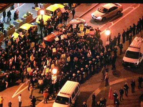 Crowd looks more compact at Penn Station with police and protesters standing face-to-face.