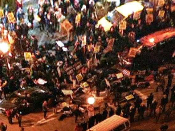 Protesters lay in street, blocking traffic, at Penn Station.