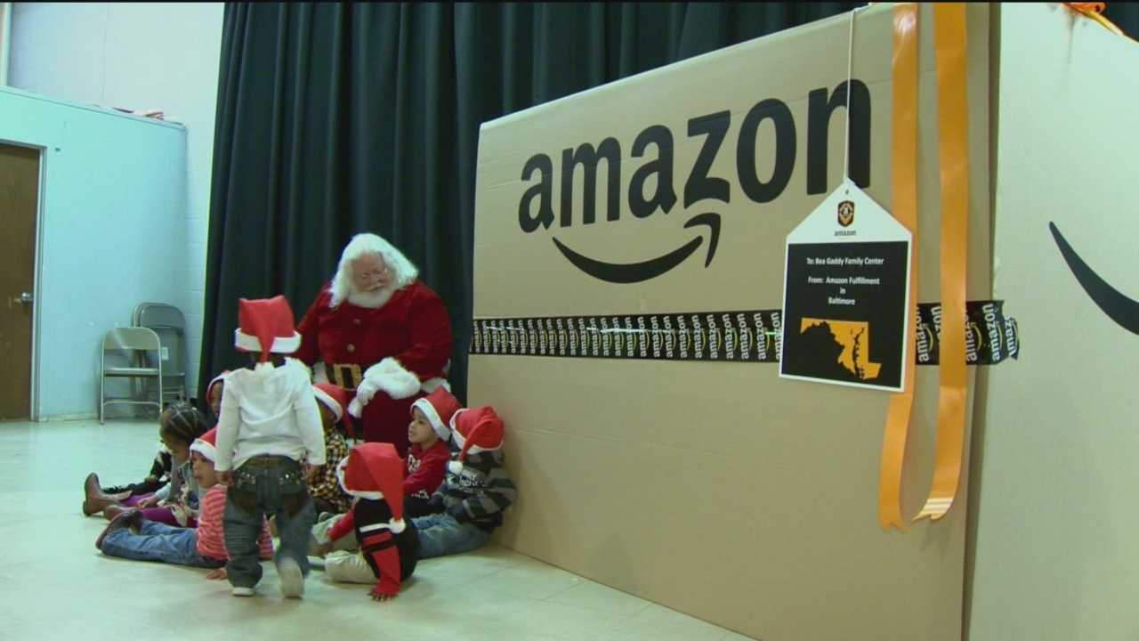 Amazon, which is opening a new fulfillment center in Baltimore, surprises the Bea Gaddy Family Center with a box full of Christmas gifts.