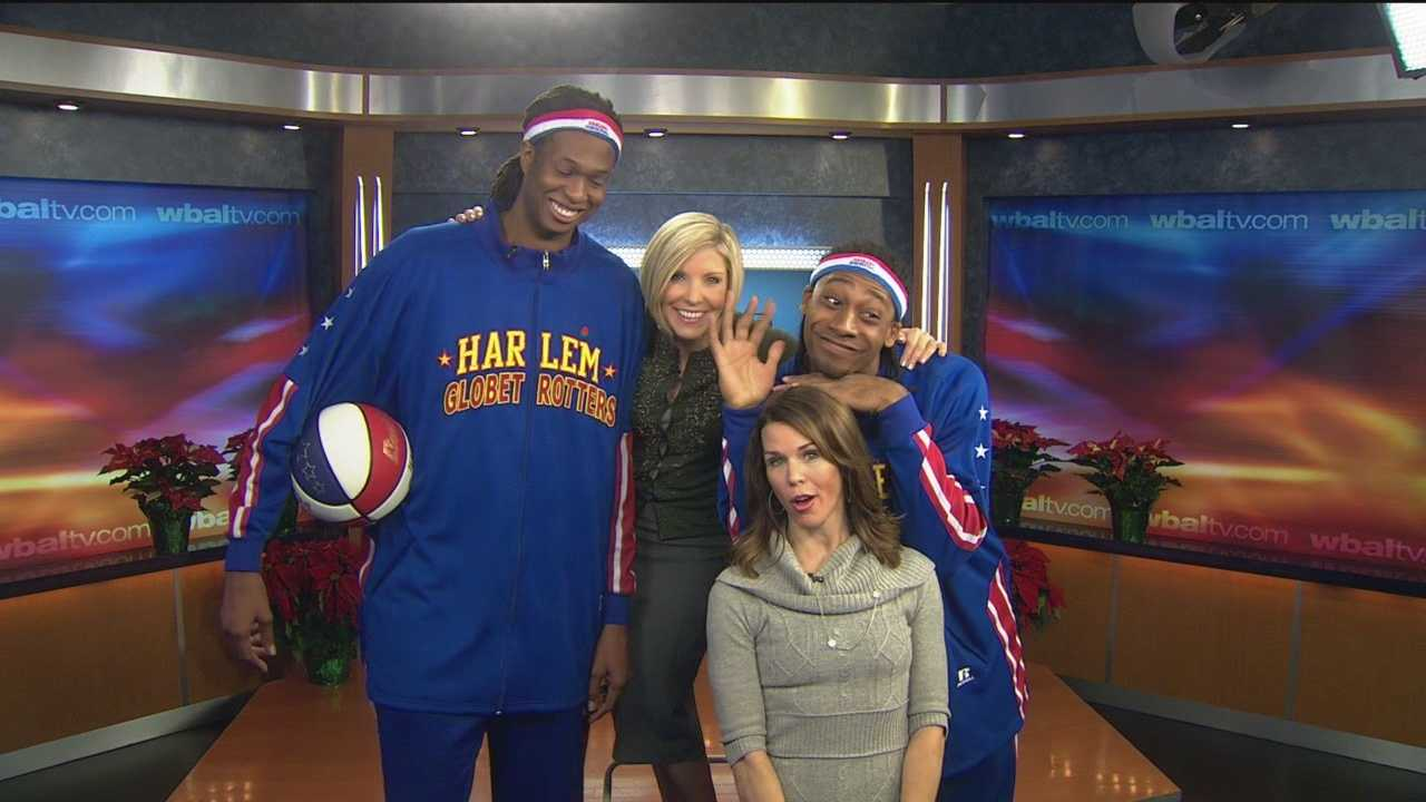 Mindy Basara and Megan Pringle feel small beside Harlem Globetrotters Stretch Middleton and Moose Weekes.