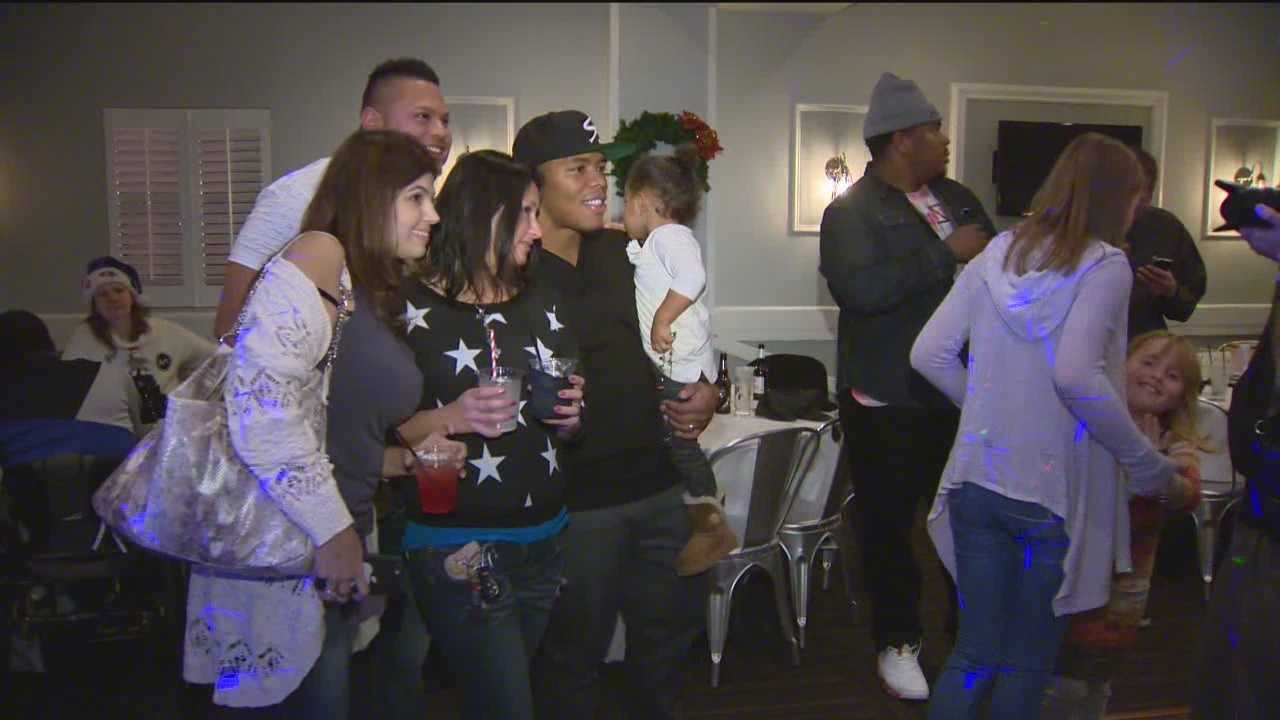 Ray Rice poses with fans at a Toys for Tots fundraising event