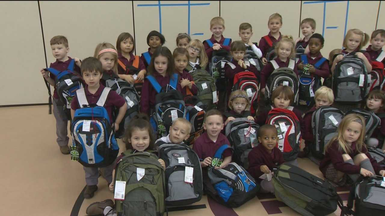 Anne Arundel County school children fill backpacks that will go to more than two-dozen local shelters.