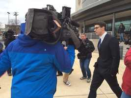 Michael Phelps leaves court after receiving probation for a DUI charge.