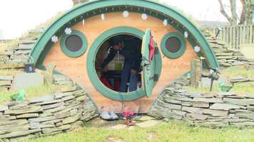 "Rem Lomat, 8, loves ""The Hobbit,"" so the Make a Wish Foundation made a tiny hobbit house for him in his back yard in Glen Burnie."