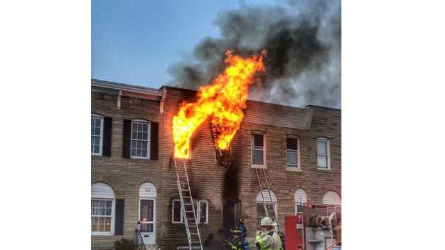 Flames could be seen coming from the home in the 300 block of South East Avenue in Highlandtown.