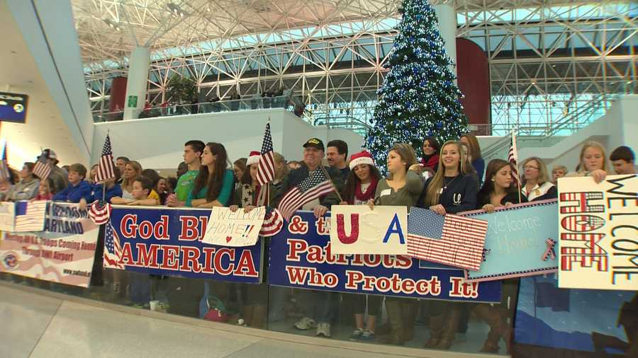 They were the last group to come back to the U.S. this year, and they came through the doors to cheers, signs and hugs.