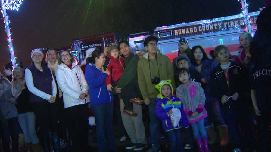 From there, the Lomat family counted down and turned on the lights to cheers from the crowd.