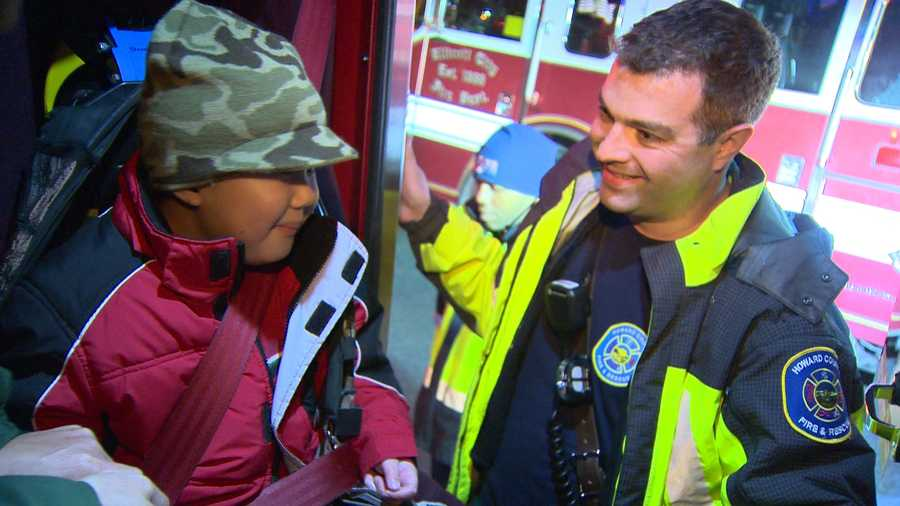 Here, Rem gets strapped in for his ride with the Ellicott City Volunteer Fire Department.