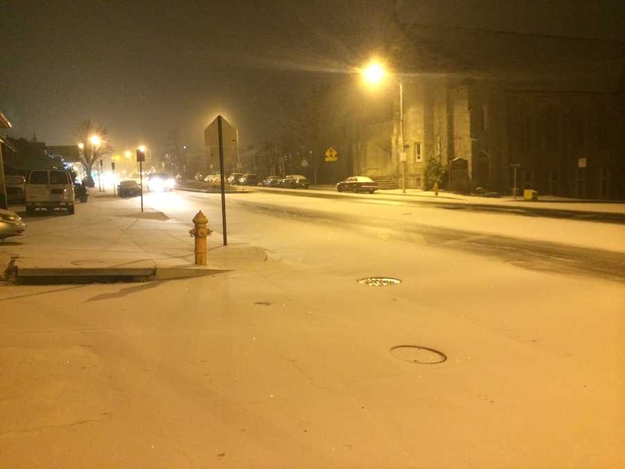 Snow covers the road in northeast Baltimore at Harford Road and Echodale Drive.
