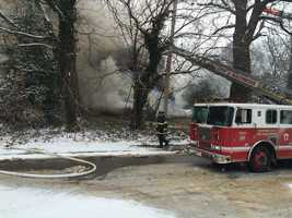 A home in northeast Baltimore was completely destroyed by a two-alarm fire Tuesday morning.