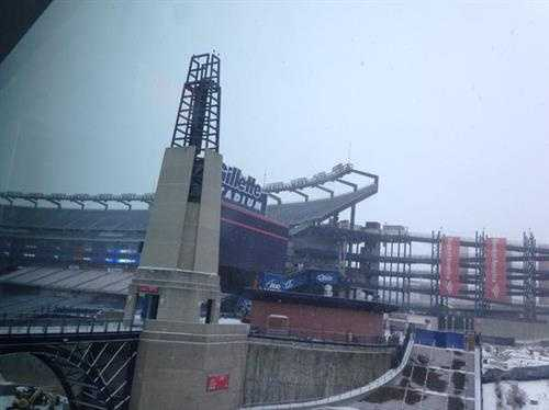 Snow falls at Gillette Stadium in Foxborough on Friday