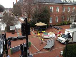 Crews prepare outside the State House for the inauguration.