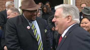 Hogan greets supporters.