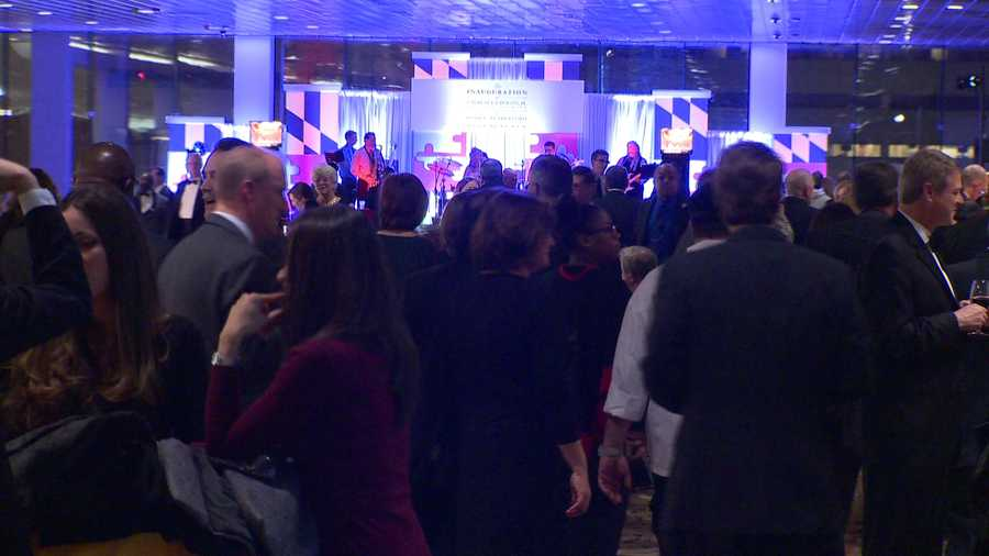 Hundreds pile into the Baltimore Convention Center for the inaugural gala Wednesday night.