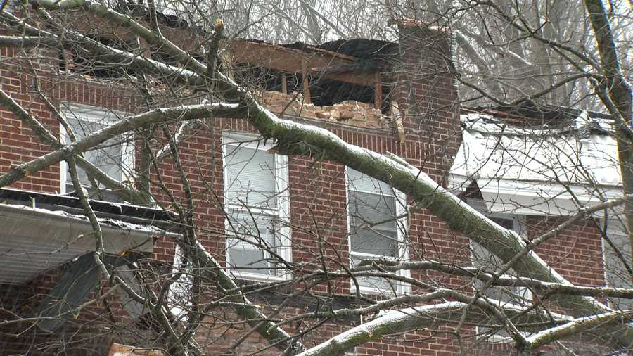 On one home, the brick and wood were exposed, and the inside of the home was visible.
