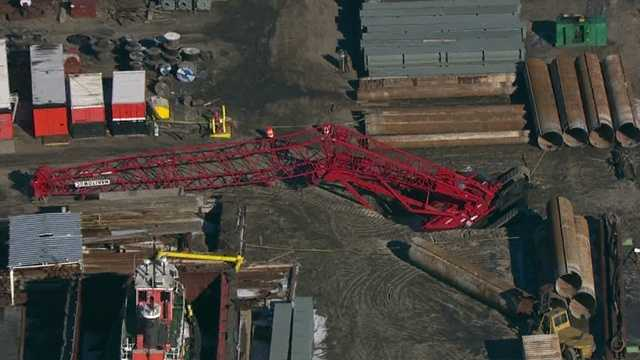 A crane topples over in Curtis Bay Wednesday morning.