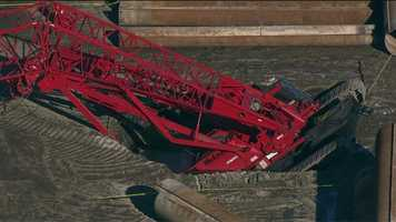 A crane owned by the McLean Contracting Co. sank into a deep hole around 9:30 a.m.