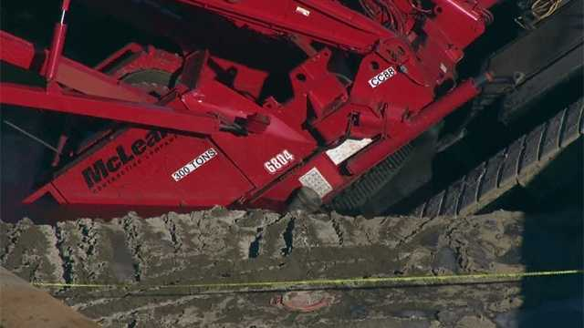 Employees with the contracting company say the ground underneath the crane gave way.