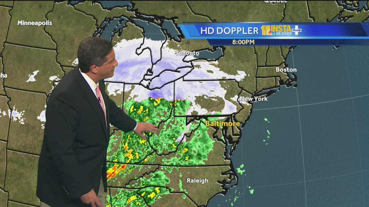 Meteorologist Tony Pann shows how light snow began falling in Maryland late Sunday night but it will change to rain by Monday morning.