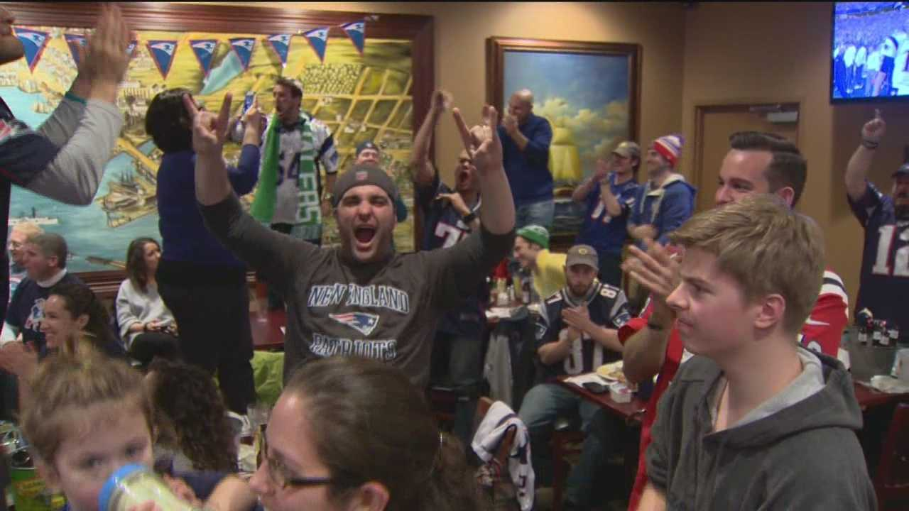 Patriots fans in Baltimore cheer on their team during the Super Bowl.