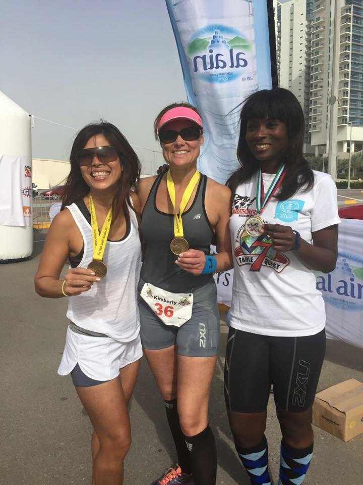 End of Race 2 in Abu Dabai: Pursely is pictured here with Sharon De Sousa and Tee Morgan.
