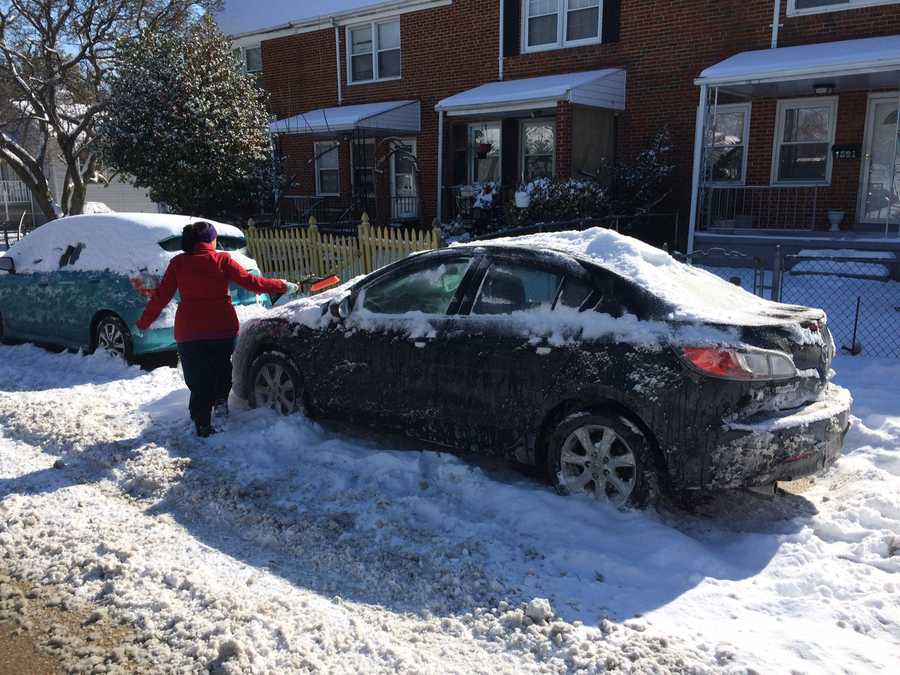 Residents in Baltimore's Hampden section dig out from the several inches of snow that came down overnight.
