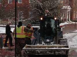 Crews work to plow the roads around the State House in Annapolis.