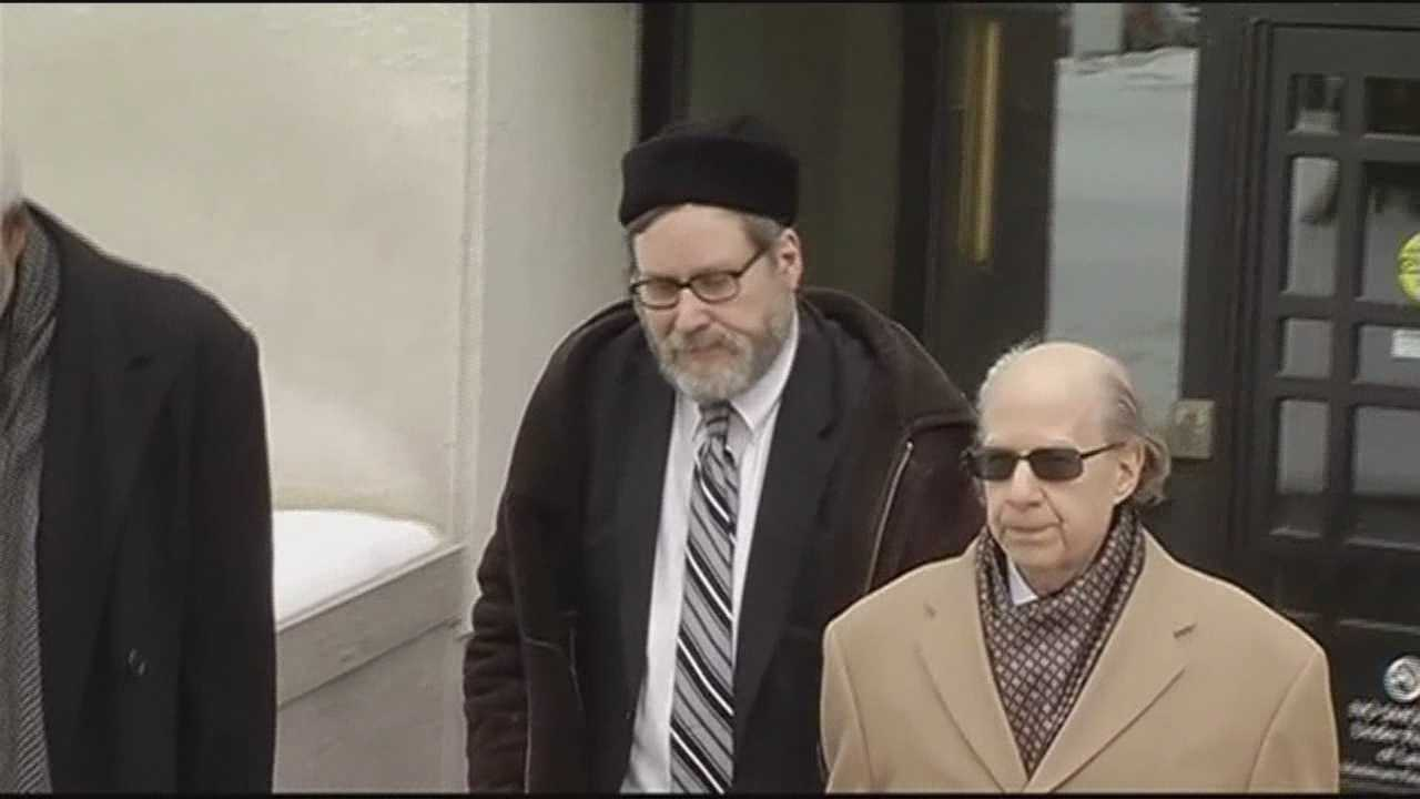 A rabbi and suspended Towson University professor accused of secretly videotaping scores of women at a Jewish ritual bath at Washington, D.C., synagogue pleads guilty Thursday to dozens of counts against him.
